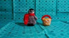 Needlefelt penguin with a bucket from a sunfelt kit