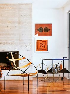 Super fresh modern interior design with mid century art and chairs