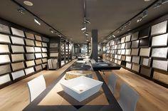Coblonal Interiorismo Showroom Pavimentos y Revestimientos Azul Acocsa Piedra