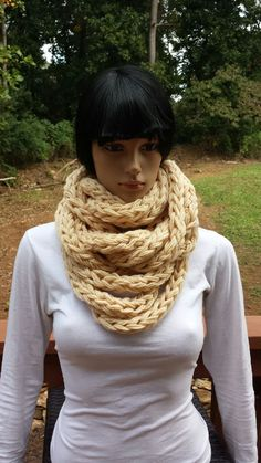 """This Chunky Infinity Scarf will quickly become your favorite, winter """"go to"""" accessory. Quick and easy, you can crochet this pattern in less than 2 hours as the bulky yarn and hook make this pattern a win-win. Crochet Scarves, Crochet Shawl, Knit Crochet, Crocheted Toys, Easy Knitting Patterns, Crochet Patterns, Crochet Infinity Scarf Pattern, Chunky Infinity Scarves, Ravelry Crochet"""