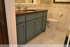 bathroom remodel - vanity made from stock oak cabinets, DIY wood butcherblock-style countertop, recessed panel walls with mosaic tile accent
