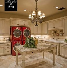 Love the spacious setup with two washers and dryers to save time. The red gives it a nice pop of color.