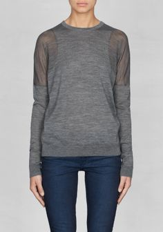 Made from warm Merino wool, this long-sleeved top features semi-transparent panels on the shoulders and sleeves.