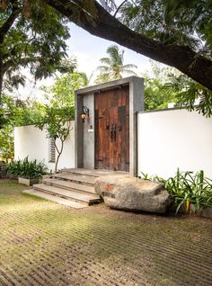 Modern Indian villas with courtyard designs. Featuring courtyard flooring, large reflection pool design, contemporary landscaping, plus luxury interior spaces. Entrance Design, Entrance Gates, House Entrance, Door Design, Exterior Design, Office Entrance, Facade Design, Courtyard Design, House With Courtyard