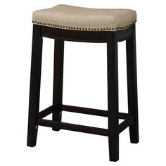 Perfect pulled up to your kitchen island or game room table, this linen-upholstered stool showcases nailhead trim and a dark walnut finished base.
