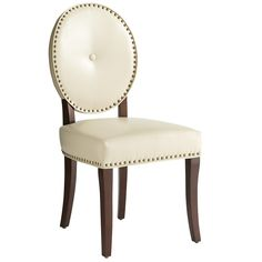 Cadence Dining Chair - Ivory: enduring style of the classic Louis chair with bold, modern detail. We kept the iconic oval back and horseshoe seat, then covered it in smooth bonded leather embellished with brass-plated nailhead trim. Also updated: Simple splayed legs replace ornate cabrioles. Each chair is handcrafted of solid wood and nicely padded. (159.99)