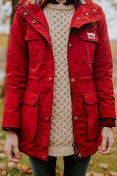 d13ac32ca2 Red rain coat by Penfield for Fall and Winter. Paired with a cozy knit  sweater to stay warm.