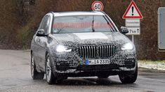 New BMW X5 drops almost all camo in new spy shots
