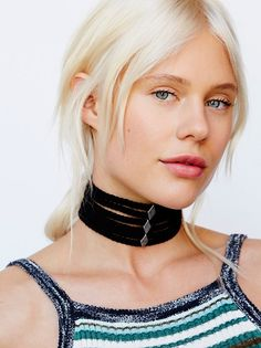 Stacked Leather Choker | Featuring braided strappy detailing this suede choker has metal charm accents throughout. Adjustable lobster clasp closure.