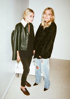 On Ashley: Leather jacket draped over the shoulders, skinny jeans, and slip-on loafers; On Mary-Kate: Black textured jacket and baggy ripped jeans