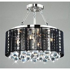@Overstock - The sparkle and shine from this five-light crystal and chrome ceiling lamp is a delight to behold. With an iron base, chrome finish, and black shade, the true stars of this fixture are the dazzling round crystals suspended on crystal chains.http://www.overstock.com/Home-Garden/Crystal-5-light-Black-Shade-Chrome-Semi-ceiling-Lamp/5689824/product.html?CID=214117 $219.99
