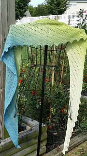 This pattern is for an asymmetric triangular shawl. Construction is such that you can keep knitting until it is as large as you like, or until you run out of yarn!