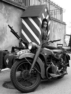 BMW R75 with a MG34 on the side car and a German soldier.