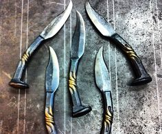 Railroad Spike Knives  I really want one. But I'd rather try and make one myself