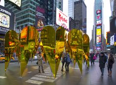 C L O K // A faceted ring of golden, mirrored hearts creates a pavilion that reflects and multiplies the pulsating activity of Times Square, creating a kaleidoscopic interior that dissolves the boundaries between viewing and performing. Pavilion, Times Square, Hearts, Activities, Ring, Architecture, Interior, Projects, Log Projects