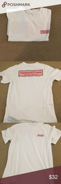 White Vineyard Vines Shirt size mens small but I wear it as a girl:))) it fits me as a medium!! It was super cute but it's not really my style anymore. worn once or twice! Super cute on and the light pink is beautiful. Is a very cute outfit will leggings or make it look like a t shirt dress. Not a tight fit shirt because it is mens- but it's a cute look for a girl. Vineyard Vines Tops Tees - Short Sleeve