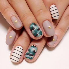 Matte nude (taupe) with simple gold stud, black white stripe, camoflage nail art. <3 mix of colors and patterns.