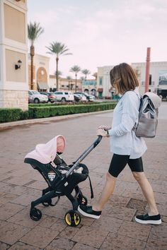 Elly Brown pushes her baby in the doona stroller while wearing faux leather biker shorts with an oversized sweater Diaper Stroller, Toddler Stroller, Car Seat And Stroller, Diaper Bags, Toddler Toys, Car Seats, City Select Double Stroller, Best Double Stroller, Baby Girl Strollers