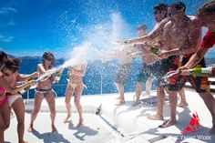 Champagne fight! Then jump in the ocean to wash it all off :)