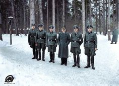 Hitler with some of his SS-Begleitkommando guards at the Wolf's Lair in East Prussia. (Left to right: August Körber, Adolf Dirr, Erich Kempka, Hitler, Bruno Gesche and Franz Schädle Colorized by Marina Amaral