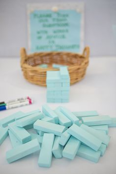 "Jenga ""guest book"" and painted all the pieces Tiffany Blue for guests to sign with nice paint markers. The color of paint is actually by Glidden and called Shimmering Blue Pool."