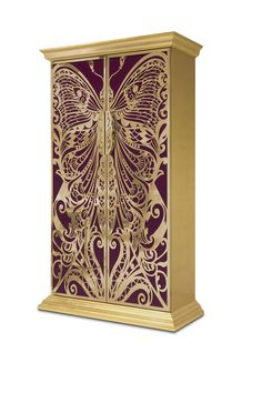 The filigree metal butterfly doors of the Mademoiselle Armoire are backed by decadent fabric and open to a metal leaf interior covered in a high-gloss varnish ➤ To see more news about Bedroom Ideas and Designs visit us at www.bedroomideas.eu @BedroomIdeas #bedroomdesigns @koket #armoires #interiordesign