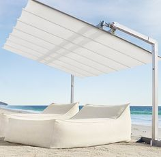Retractable Accordion Umbrella for over the little ones' play area.  Canopy is 10x14. On sale $6K