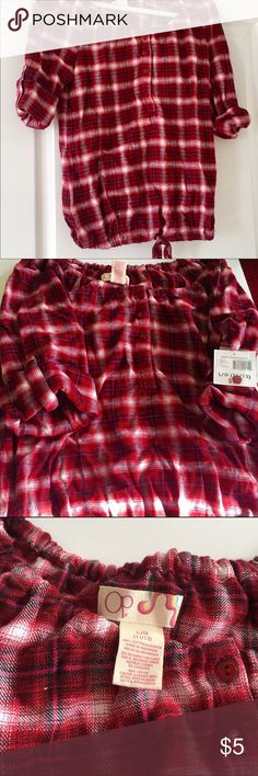NWT OP flannel peasant red plaid top NWT This lightweight flannel plaid peasant top from OP. Plaid is red based with black, white and pink checks. Shirt has rolled sleeves and a drawstring bottom allowing adjustment for comfort. Tags still on with additional extra button. 15% off bundles of 3 or more.                       No trades.                                                            No Holds.                                                           No Sales outside of Poshmark…