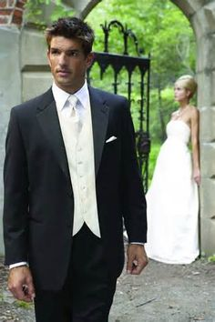 Groom tuxedo with Ivory vest and tie