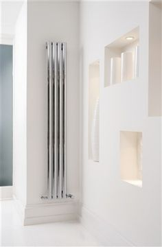 This vertical radiator generates a large amount of heat. This is the vertical version of the Sofi, for the horizontal version see 'Sofi Horizontal' Available in White and Chrome Wall Radiators, Vertical Radiators, Radiator Valves, Radiator Cover, Electric Radiators, Designer Radiator, Central Heating, Sconces, Wall Lights