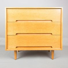 A stylish and top quality retro chest of drawers in light Oak, this was designed by John and Sylvia Reid for the Stag C range.  This dates from around the 1950s, and has just been stripped and re-polished, the condition is good for its age. Measurements  Depth: 46 cm  Width: 76 cm  Height: 74 cm  Contact us for further information or to ask about sourcing additional complementary items.  PLEASE NOTE THIS PIECE IS PRICED FOR COLLECTION ONLY.  We can provide quotes for delivery or arrange or…