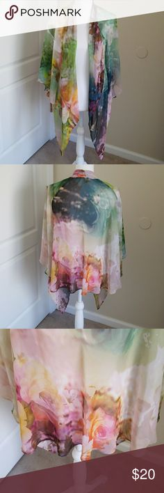 Vintage Floral Kimono by Chenault Beautiful floral vintage Kimono by Chenault. Has beautiful colors throughout it. Will go with any color. I measured 25 inches long from neck to bottom in back. Size XL. Will fit a large and medium. Preowned. EUC. Any questions please ask. Chenault Tops