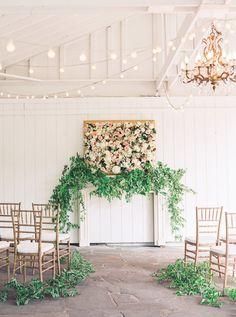 A framed flower display with greenery garland galore - utter perfection! #cedarwoodweddings Navy, Blush and Gold Inspiration :: Cedarwood Weddings+Julie Paisley | Cedarwood Weddings