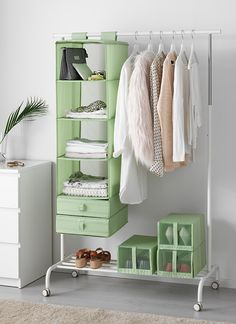 Create your own standing wardrobe by combining affordable hanging organizers! Click for more ideas to get organized in every room of your home.