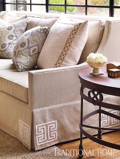 Square appliqués by Mary McDonald for Schumacher add swanky detail to the skirt of the sofa. - Photo: Emily Jenkins Followill / Design: Chenault James