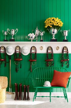 An ode to the world of polo, Ralph Lauren Paint's preppy Green Jacket decorates the stable walls.