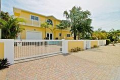 Alina Davis Team - Realtors in Islamorada, FL  Keys living at its finest! This Venetian Shores home has everything you could want! With 4 BR plus an office, 4 BA, interior stairs, garage, heated pool & hot tub, 20,000lb. boatlift AND 7,500lb. davits, this home is ready for family fun and entertaining. CBS construction and a concrete roof keep insurance costs reasonable. This home has been meticulously maintained and is ready for a new family!