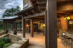 Distressed Wood Posts, Architect: INsite Architecture Inc - Out door porches provide cover for lakeside living (Photo by VJ Arizpe) Rustic Porches, Montana Homes, Lakeside Living, Home On The Range, Lake Cabins, Dream Barn, Timber House, Farm Houses, Distressed Wood