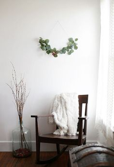 """""""Decorating for the holidays"""" often feels like an expensive and time-consuming undertaking, but there's another way to do Christmas: embracing the Danish concept of hygge (simple, cozy and comforting). Often nature-inspired and monochrome in look, check out these ideas for a Scandi-inspired, minimal holiday at home"""