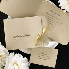 This golden side-fold invitation features your verse printed on the inside with your first names printed on the cover. Tie it all together with a golden satin ribbon.