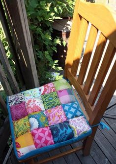 Comfort Meets Quilting Chair Cushions - If you think quilts are comfy on couches, imagine what they'll be like on your dining room chairs! The Comfort Meets Quilting Chair Cushions are a creative way to soften those hard wooden chairs of yours while also giving your dining room or kitchen a fresh new look! These bright DIY chair cushions are comfortable enough to fall asleep on, but cheery enough to light up a room.