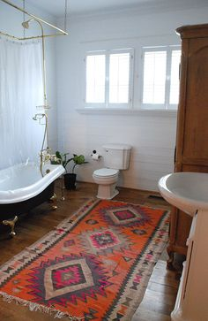 white bathroom with patterned rug
