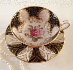 Beautiful Cabinet Duo Paragon China Tea Cup & by TheEclecticAvenue
