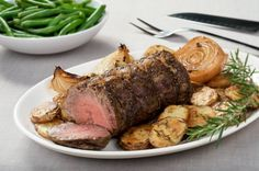 The cap of a prime ribeye was rolled, tied and roasted along with rosemary Yukon Gold potatoes and sweet onions.  Steamed green beans are served alongside in casual family style.