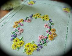 Check out this item in my Etsy shop https://www.etsy.com/uk/listing/465934462/hand-embroidered-vintage-floral-linen