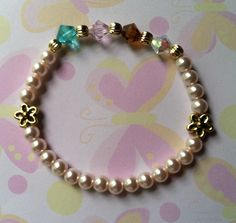 GrandMother's Bracelet Birthstone months April, Dec, Nov, & Oct made with Lt. Pink pearls, Brilliance crystals & Gold tone flower accents. Sold