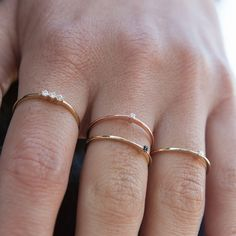 This gorgeous three diamonds stones stacking ring is hand-forged in 14k solid gold will be made with your desired birthstones and material. The delicate ring band measures 1 mm thick, making this ring ideal for stacking. We recommend this ring if you plan on wearing this ring every