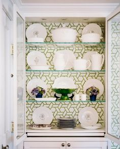 Get a gorgeous wallpaper and recover your china cabinet like maison decor has done so beautifully...