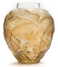 R. LALIQUE CLEAR AND FROSTED GLASS ARCHERS VASE WITH SEPIA PATINA . Circa 1921. Engraved: R. Lalique, France.