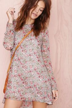 This is a great dress, would be super cute with maroon tights and boots.